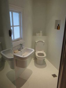Wetroom designed to fit corner of property