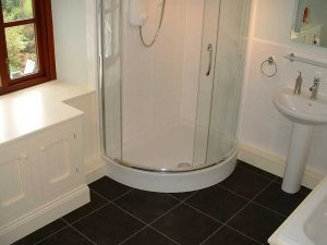 Corner shower cubicle fitted to bathroom by Peter Robinson Installations