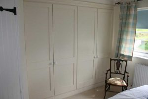 Cream fitted bedroom wardrobes by Peter Robinson Installations