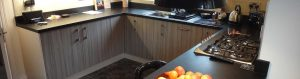U shape kitchen in grey and black