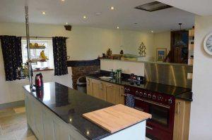 Oak kitchen with black granite worktops