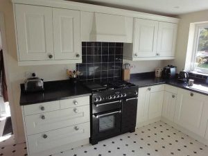 Showcasing a cream and black kitchen