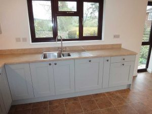 painted finish kitchen with curved bespoke worktops