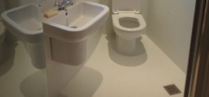 Wet room fitted in corner bathroom