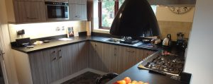 Peter Robinson Installations Modern Kitchen with black worktops and matching lighting