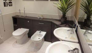 Luxury double sink bathroom with fitted wall cabinetry