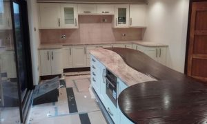 Custom build Fish Island worksurfaces with granite top and pink wall spalshbacks