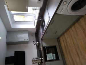 High gloss grey kitchen renovated by Peter Robinson, Monmouth