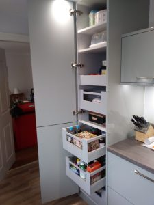 Pull out storage system in high gloss kitchen