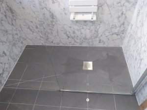 Accessible shower area in wet room