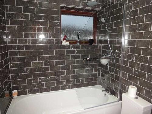 Grey marble effect bathroom